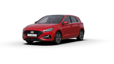 Front side view of the new Hyundai i30 in the colour Engine Red.
