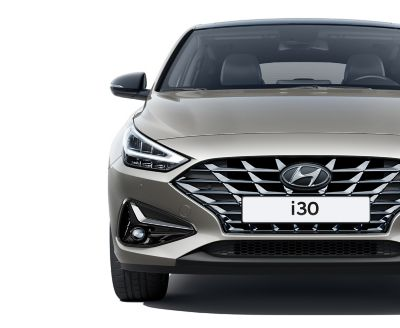 The new Hyundai i30 Fastback pictured from the front, focused on the headlamp.